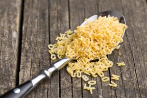 alphabet pasta in spoon